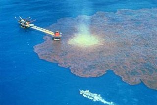 a leaking oil tanker causes an oil spill in sea