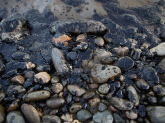 PICTURE: Spilled oil covers the beach at Refugio State Beach on May 19, 2015 north of Goleta, Calif.